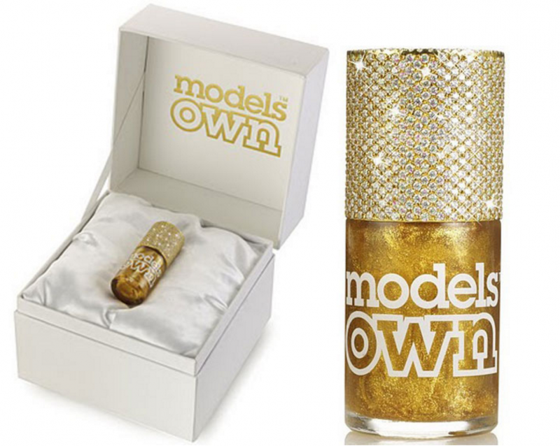 models own Gold Rush Couture polish in a bottle with a real yellow gold cap studded with 1,118 diamonds.
