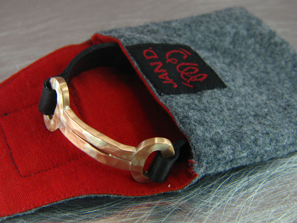 forged bracelet in pouch