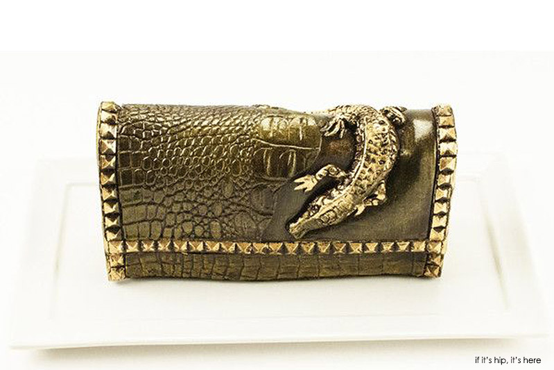 crocodile bag is filled with dark chocolate cake and painted with edible gold luster