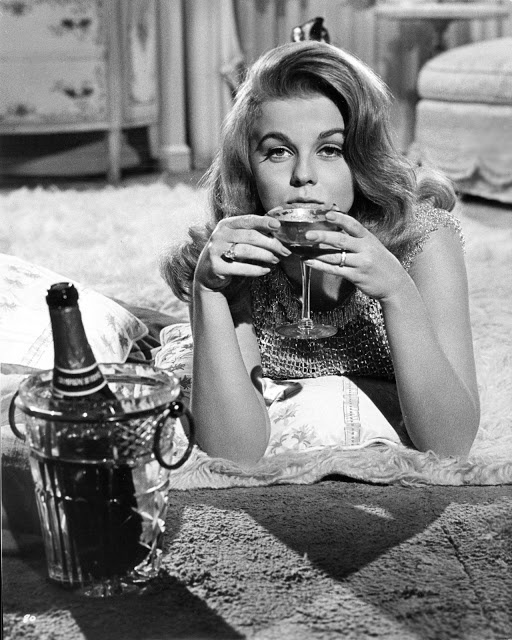 Ann Margret sipping champagne