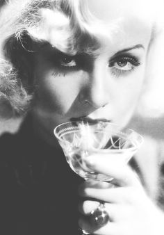 Carole Lombard sipping champagne