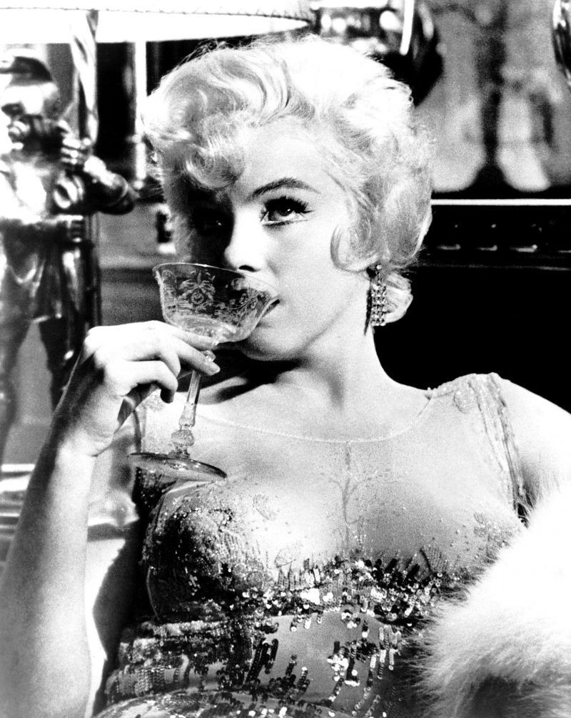 Marilyn Monroe sipping champagne