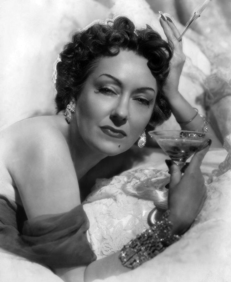 Gloria swanson sipping champagne