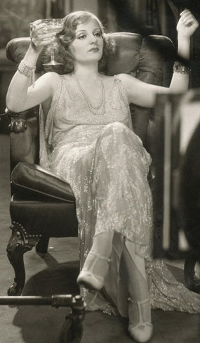 Tallulah Bankhead sipping champagne