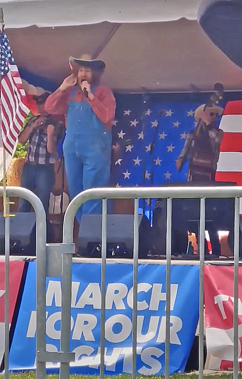 Sasha Baron Cohen in disguise and performing at the rally