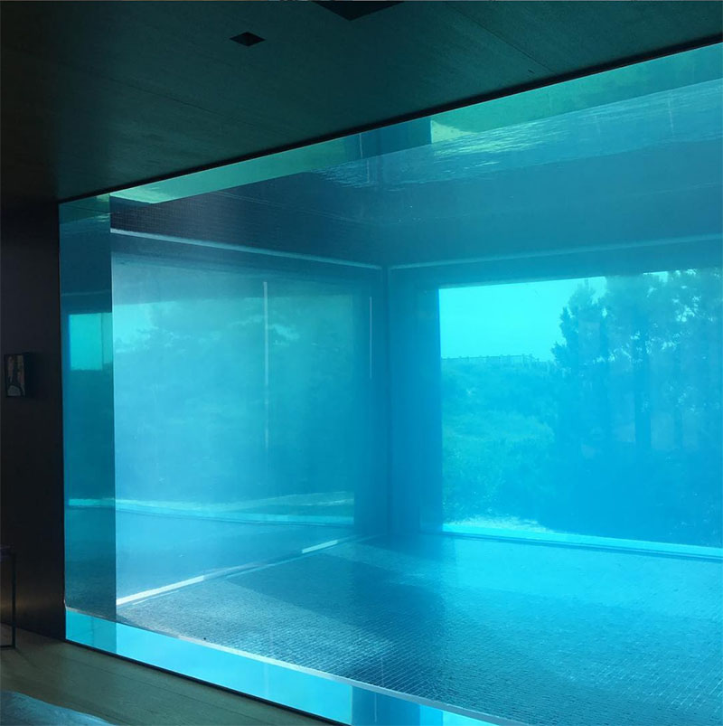 Liquidity House transparent pool windows seen from the interior