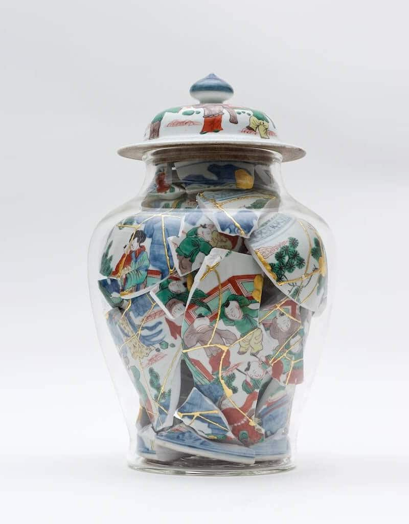 pottery shards in glass containers