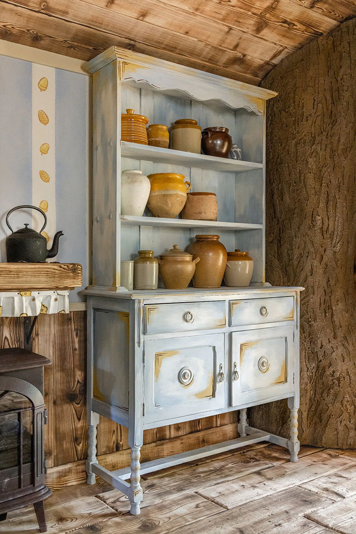 hutch filled with 'hunny' pots