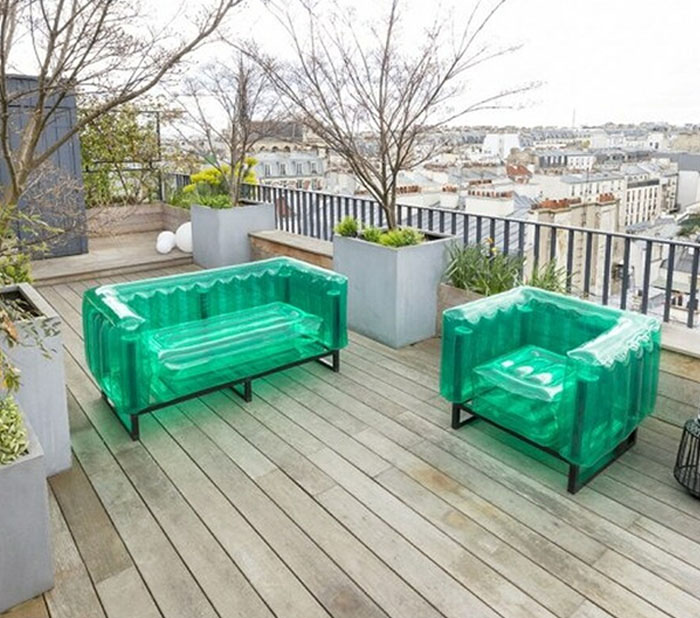 Green blow-up sofa and armchair with metal frames